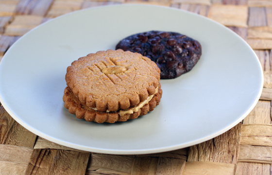 A peanut butter sandwich cookie and a chewy, fudgy flourless chocolate cookie.