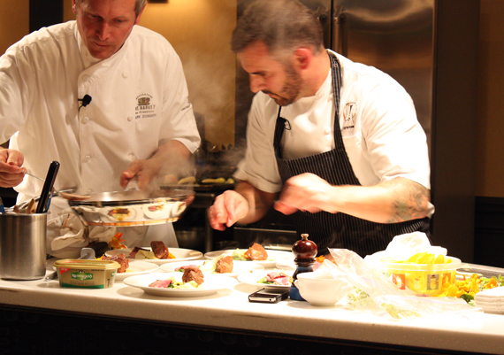 Chef Mark Dommen (R) and Chef David Bazirgan (L) begin to plate their lamb dish in the first chef's challenge at SF Chefs.