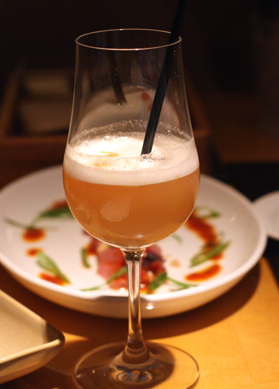 Madame Genever cocktail with a float of frothy egg whites.