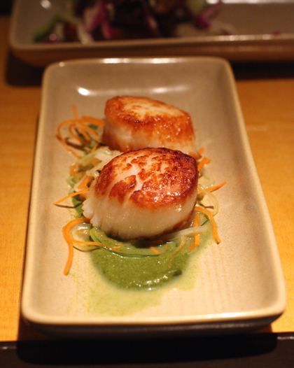 Scallops on a pool of green Thai curry.