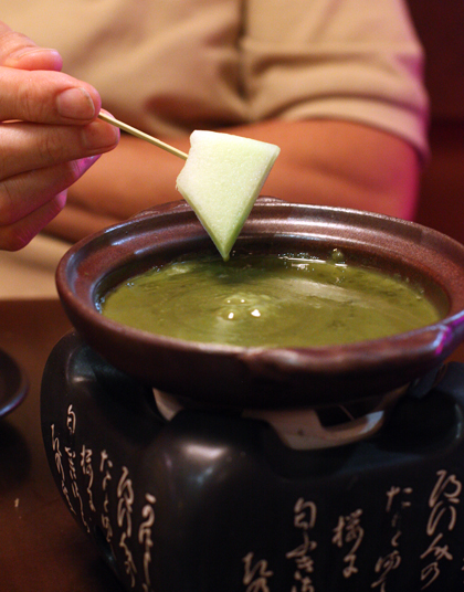 The green tea-white chocolate sauce is warm, thick, sweet and just faintly bitter from the aromatic tea.