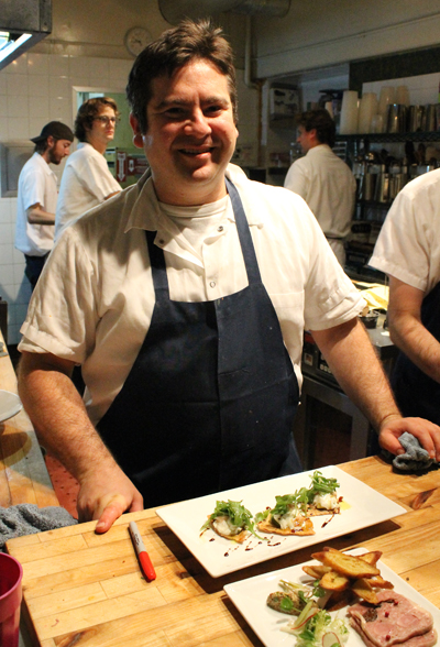 Give a wave to Chef Jeff Banker when you pass through the kitchen to get to your table in the bakery.