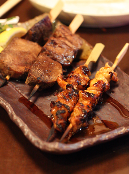 Smoky, grilled skewers of beef tongue and chicken skin.