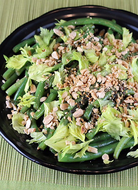 Green beans with brown butter, Asian fish sauce, crushed peanuts and celery leaves.