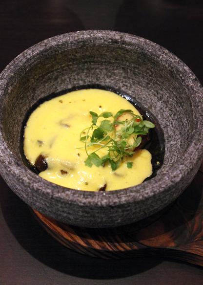 A butternut squash foam hides mushrooms and a scallop with foie gras oil.