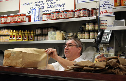 Behind the counter at Schwartz's.