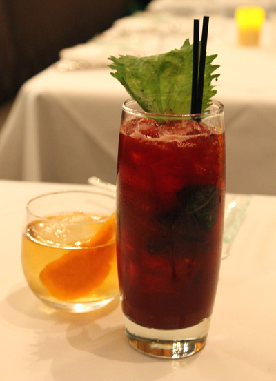 A shiso cocktail (front) and a Manhattan (back).