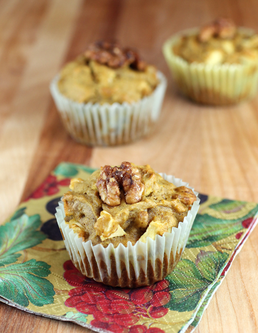 Moist apple pumpkin muffins crowned with a walnut half.