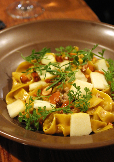 Pork bolognese atop tagliatelle with apples and almonds.