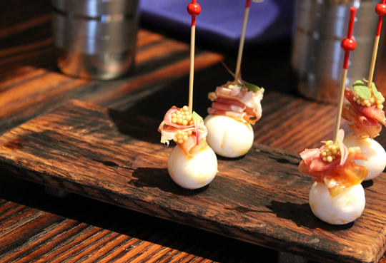 A pintxos of quail egg and jamon Serrano. Bet you can't eat just one.