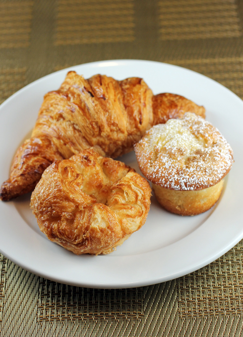 Front and center, the incredible kouign-amann from B. Patisserie, as well as a croissant and an apple brown butter coffee cake.