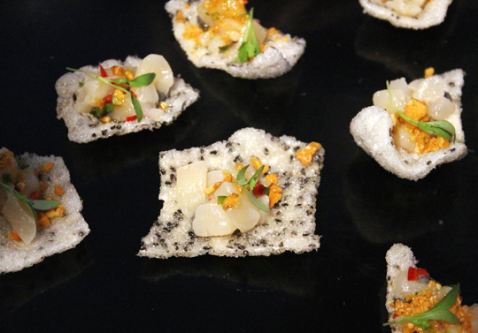 Day boat scallop with kaffir lime on black sesame crackers -- by the new chef of Betelnut, Mario Tolentino.