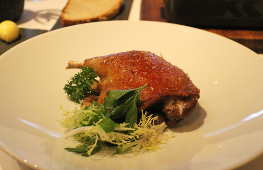Duck confit with cranberry beans.