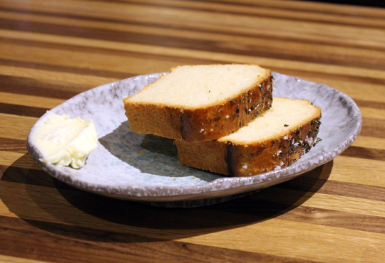 Slices of brioche with herb butter.