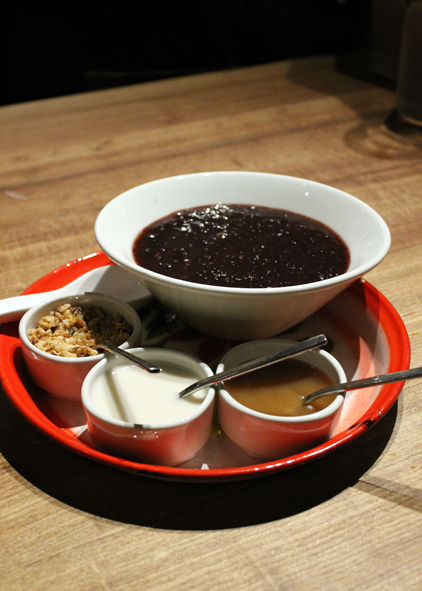 Warm black rice pudding for dessert.