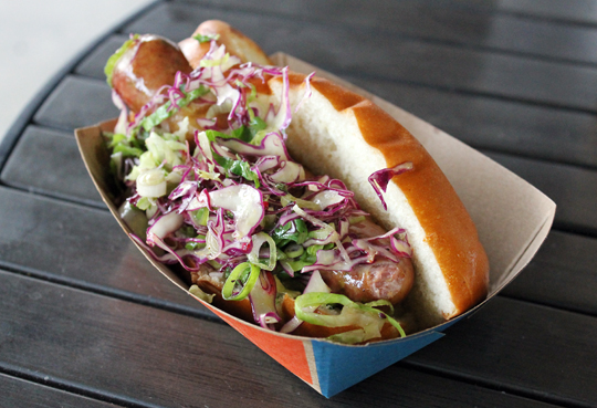 A juicy sausage with a spritely slaw.