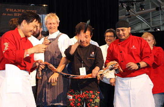 Chef Martin Yan yucking it up for the cameras as he uses his knife skills on the fruit leather (rather than ribbon) that was cut to mark the opening of the festivities.