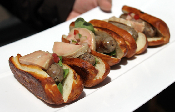 Miniature duck dogs with foie gras torchon on pretzel buns by Chef Victor Scargle.