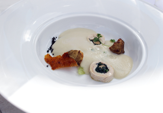 Chef Esnault's sunchoke veloute with guinea hen, foie gras and black truffle.