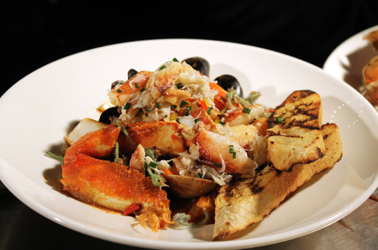 Zare's demo of Italian seafood stew with Persian flavors.