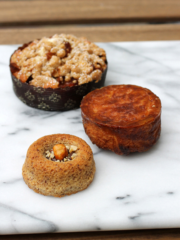 Brown butter hazelnut cake (front), kouign amann upside-down as displayed in the bakery case (middle), and coffee cake (back).