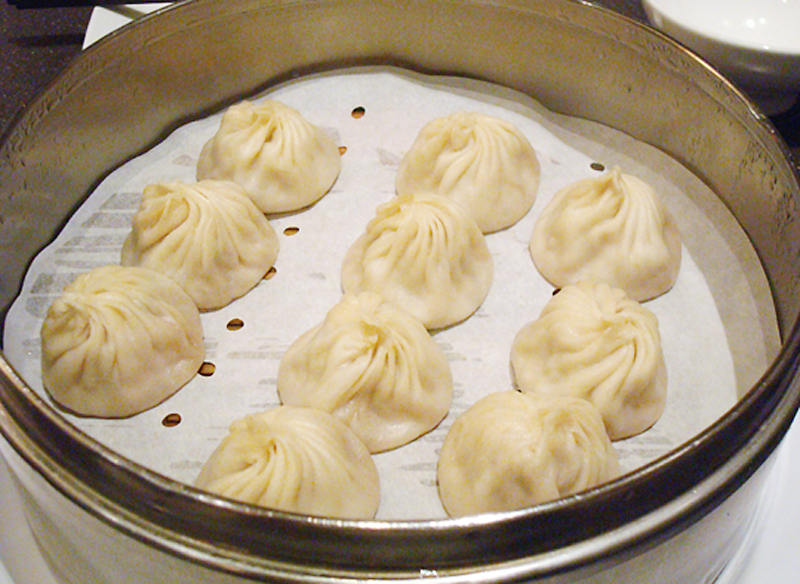 Soup dumplings fresh out of the steamer at Din Tai Fung in Arcadia. (Photo by Carolyn Jung)
