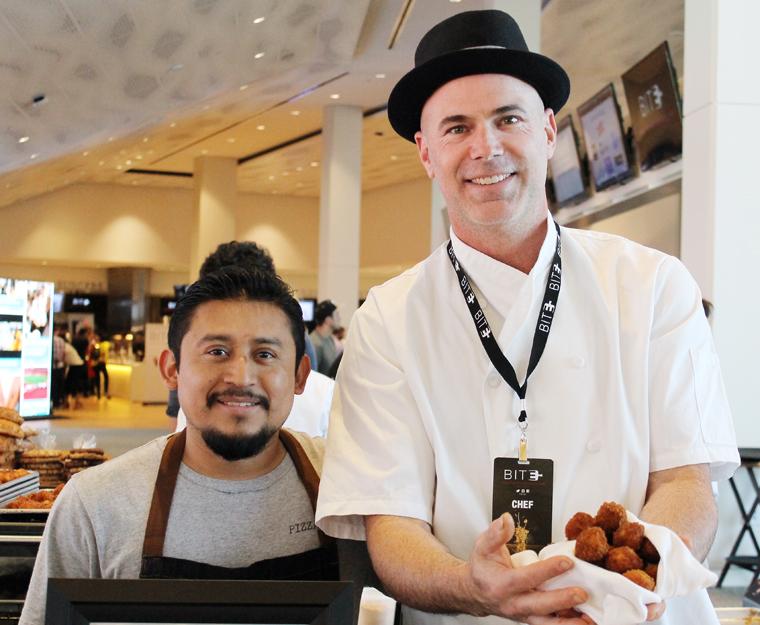 Executive Chef Bradley Ceynowa and his sous chef serving up pork ragu arrancini.