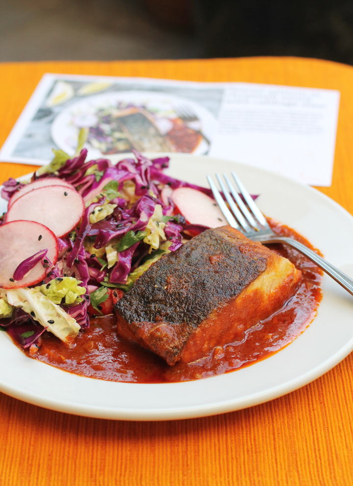 The resulting salmon in chraimeh sauce with cabbage slaw.