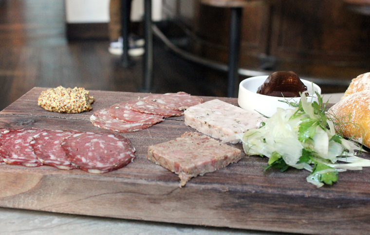 The charcuterie board with four selections.