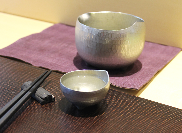 Sake served in pewter cups.