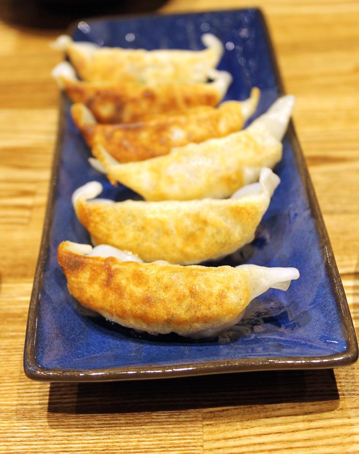 Golden, pan-fried pork dumplings.