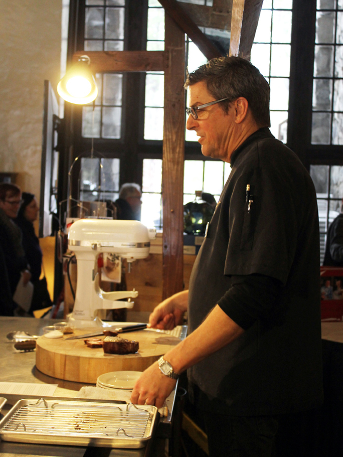Chef Ken Frank cooking steak at his demo.