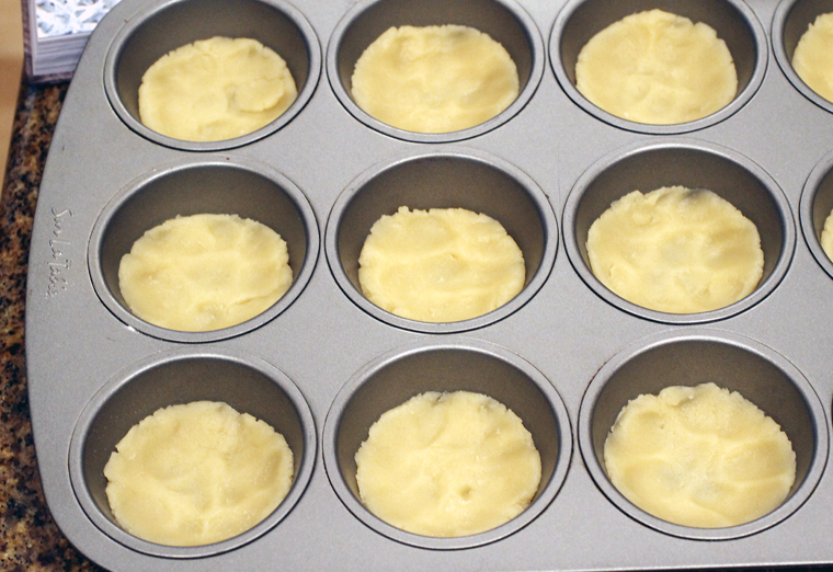 Just press the dough into the bottom of a muffin tin.