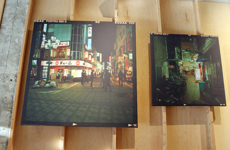 Holzman's photos of Japan adorn the back wall.