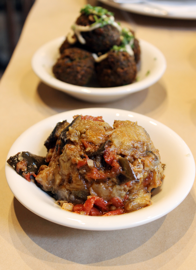 Stewed, chunky eggplant (front), and falafel balls (back).