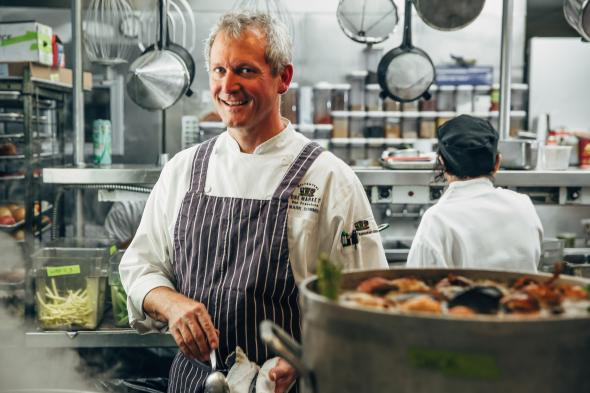 Chef Mark Dommen in the kitchen at One Market. (Photo courtesy of One Market)
