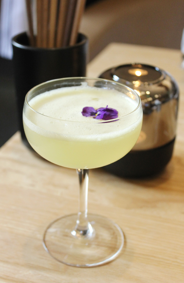 """A foamy, gin-based """"Stir the Meadow'' cocktail ($14)."""