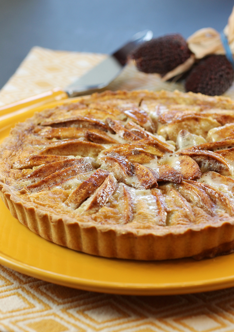 A tart full of tender apples and delicate custard.