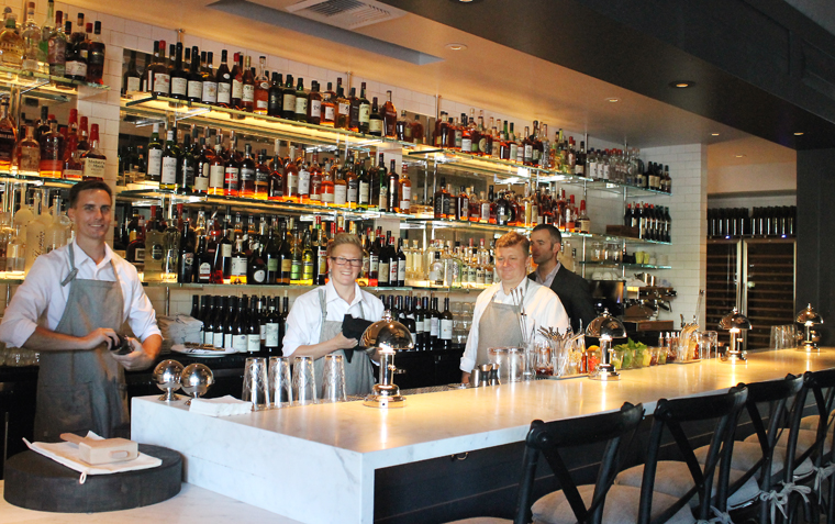 The elegant bar greets you after walking through the doors of the restaurant.