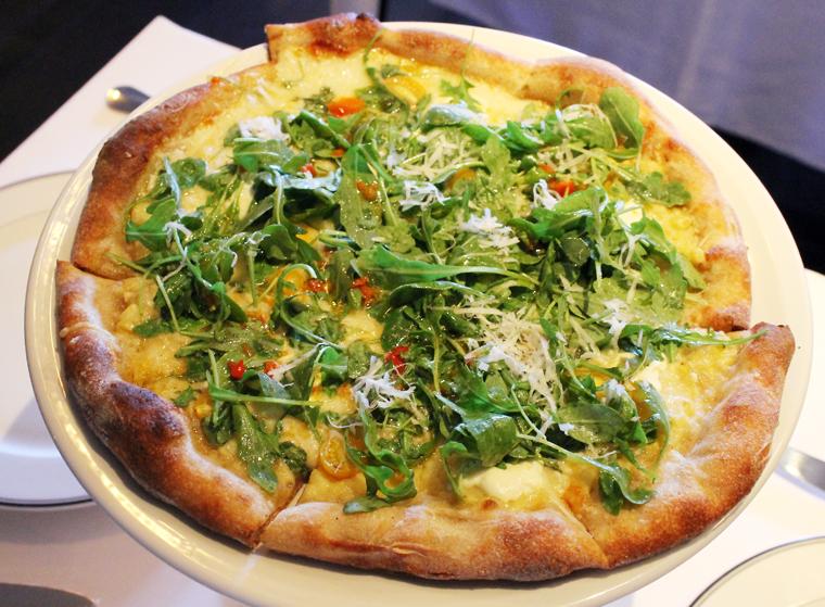 Corn, tomato and arugula pizza.