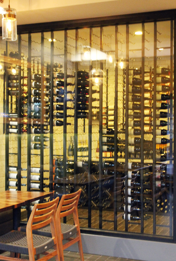 The wine cellar in the corner of the bar.
