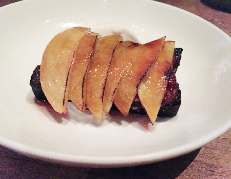 Bruleed boozy nectarines on a buttery cake.