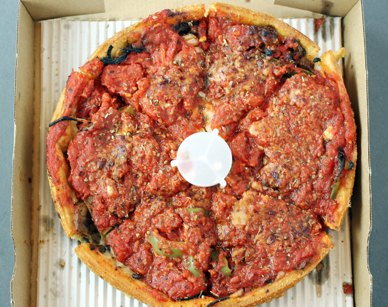 The sausage deep-dish, delivered freshly baked and hot. (photo by Carolyn Jung)