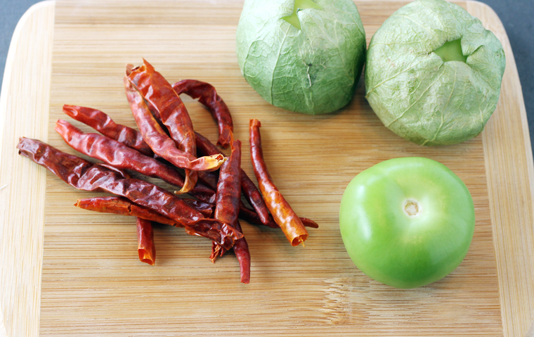 Dried chiles de arbol, and regular tomatillos.