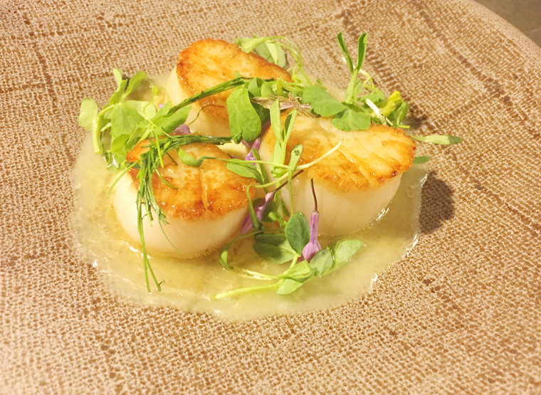 A popcorn-infused cream and butter sauce garnishes Fox's scallops.