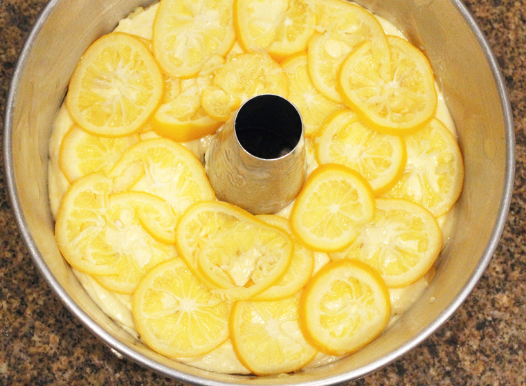 The cake gets two layers of blanched Meyer lemon slices.