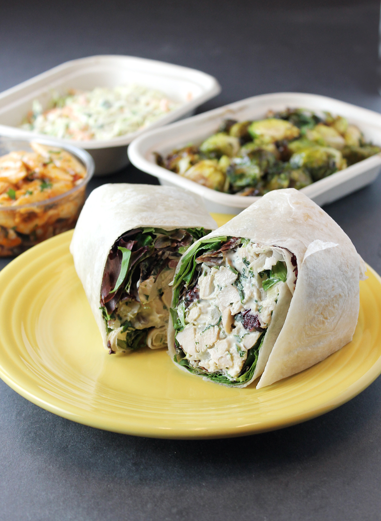 A bountiful smoked chicken wrap, coleslaw, Brussels sprouts and pasta salad from Luke's Local.