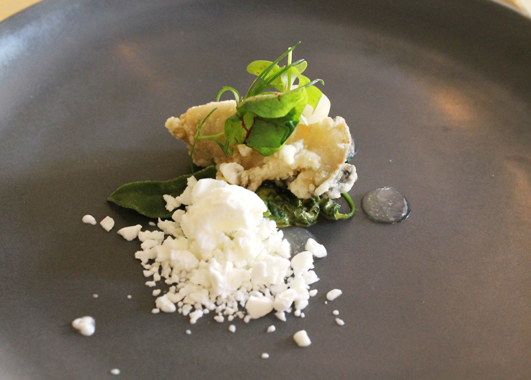 Fried oyster with frozen horseradish cream.