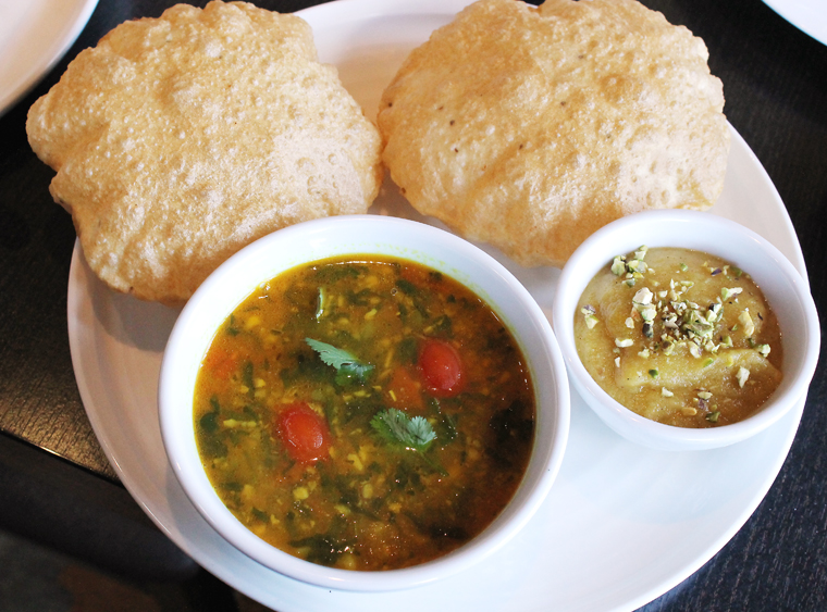 Poori Aaloo -- little puffy breads with sides both sweet and savory.