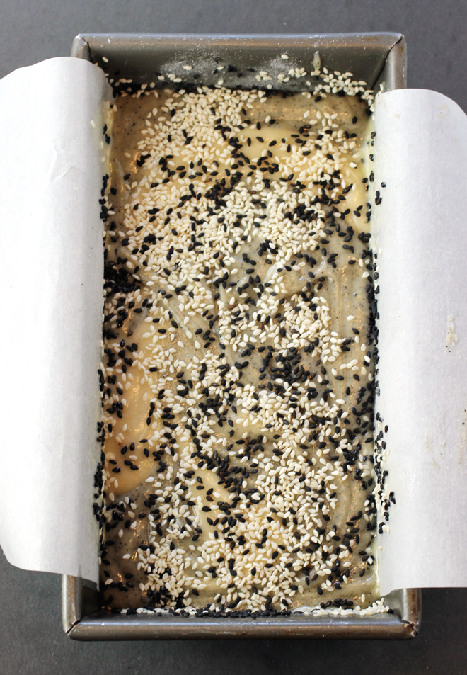A final flourish of black and white sesame seeds is strewn over the top before baking.